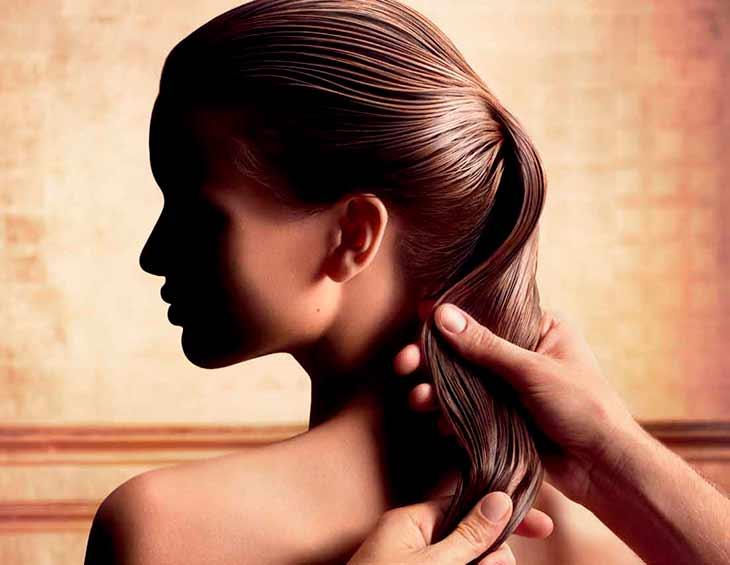 Репейное масло в волосах